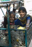 "Children having the time of their life in a small hand-operated ""ferris wheel"" in Chandni Chowk, Old Delhi"