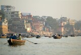 The Ganges river, Varanasi - tourists float serenely down the river just after dawn