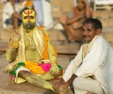 "The Ganges river, Varanasi - a ""sadhu"" - most likely a business proposition rather than a holy mission, gets a foot massage.   Even sadhus get sore feet?"