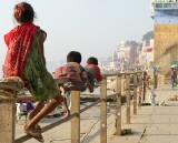 Children playing on the fence, Mir Ghat, Varanasi