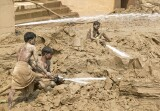 The level of the Ganges fluctuates by more than 10 metres between the monsoon and dry seasons.  As the highest waters recede they leave deposits of silt that have to be hosed away by contractors in a never ending cycle